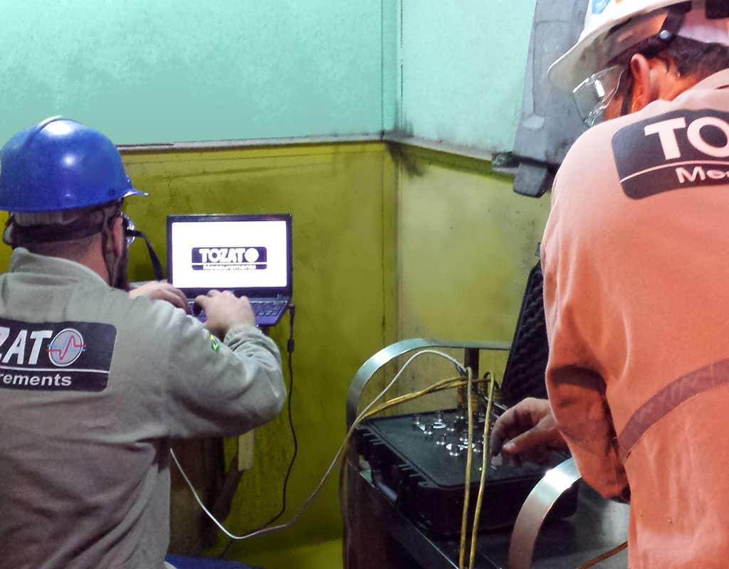 Tozato Measurements Team using a Tozato Oscillation Checker