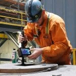 Man measuring a copper mould at steelmill